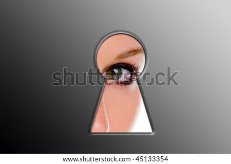 Woman looks through a keyhole