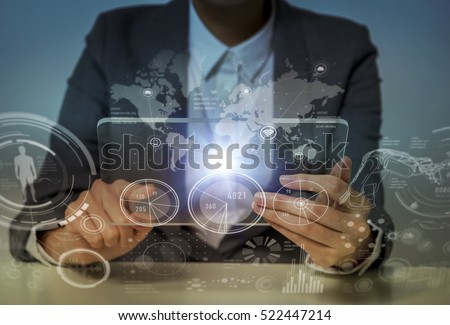 woman looks transparent monitor panel that indicates technological graphics, futuristic GUI(Graphical User Interface), IoT(Internet of Things), technological abstract