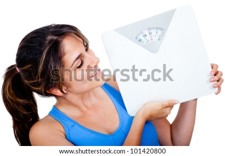 Woman loosing weight holding a scale - isolated over a white background