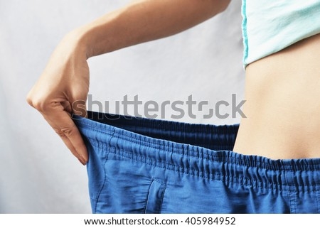 woman lose weight , diet concept background