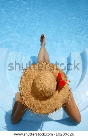 Woman lying in blue pool