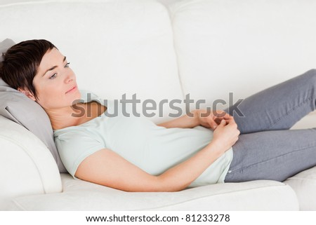 Woman lying on a couch in her living room