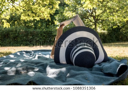 woman lying on a rug in the...
