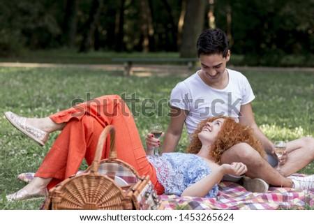 Woman lying on her boyfriends lap #1453265624