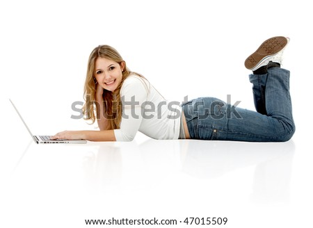 Woman lying on the floor with a laptop isolated over a white background