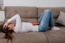 Woman lying on with menstrual colic.