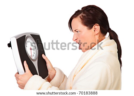 Woman mad at her scale shakes it