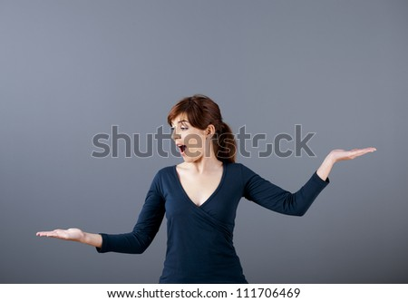 Woman making a scale with her arms