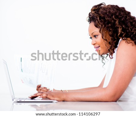 Woman making an online payment of her bills