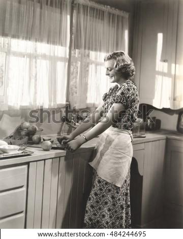 Woman making homemade orange juice