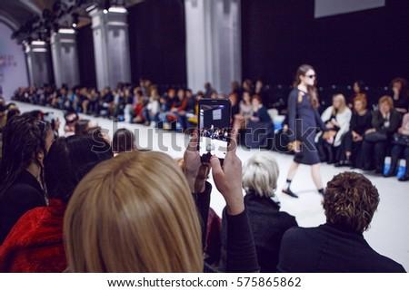 Woman making photos on fashion show #575865862
