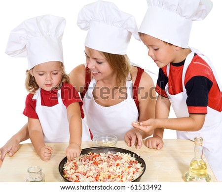 Woman making pizza with her kids at home - isolated