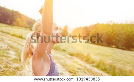 Woman making respiration exercise in the nature
