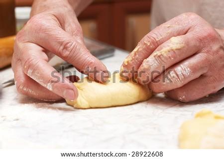Woman making small pasties