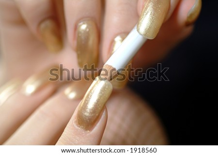 Woman making up her nails