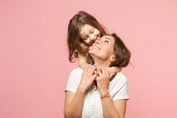 Woman mama in light clothes have fun with cute child baby girl. Mother little kid daughter isolated on pastel pink wall background studio portrait Mother's Day love family parenthood childhood concept