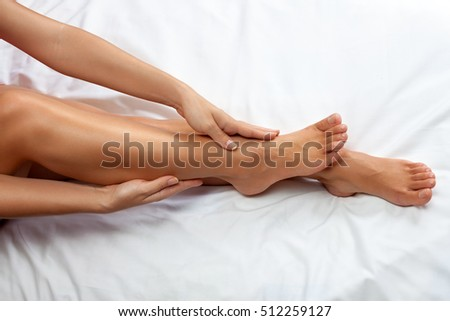 Woman massage her tired  legs and ankles  #512259127