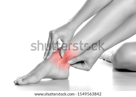 woman massaging her painful ankle on white background Photo stock ©