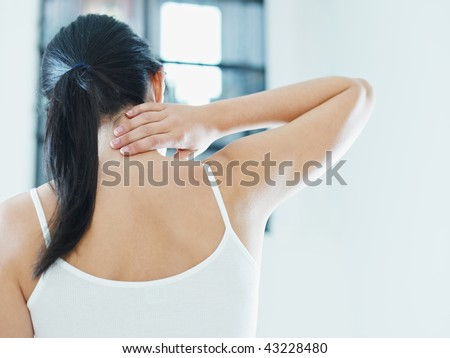 woman massaging neck. Rear view, copy space