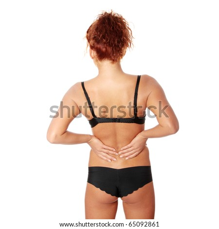 Woman massaging pain in her back, isolated on white
