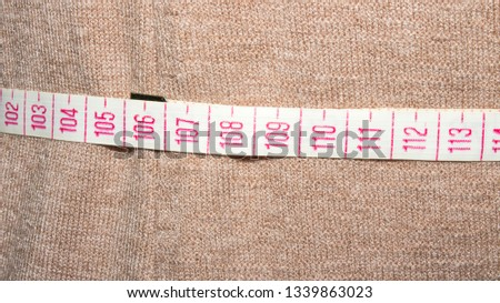 Woman measures waist size.Measurement of waist size. #1339863023