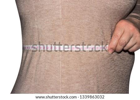 Woman measures waist size.Measurement of waist size. #1339863032