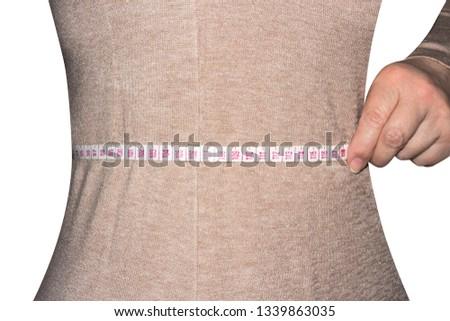 Woman measures waist size.Measurement of waist size. #1339863035