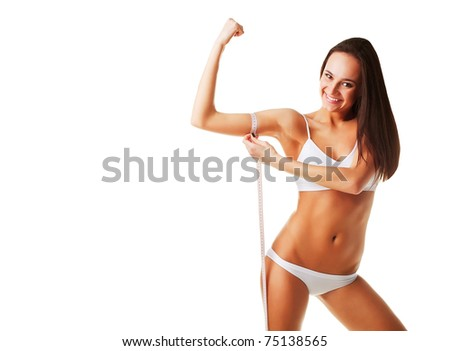 Woman measuring her muscles on white background