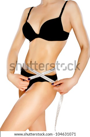 Woman measuring perfect shape . Healthy lifestyles concept