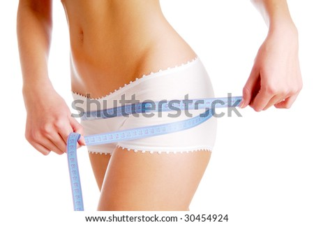 Woman measuring perfect shape of beautiful hips