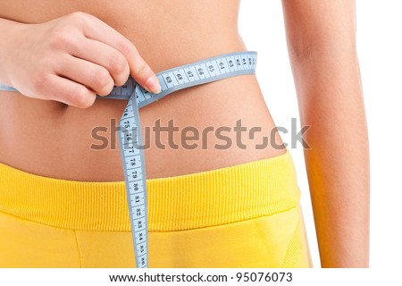Woman measuring perfect shape of beautiful thigh. She lose weight