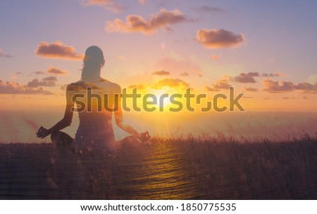 Woman meditating in a beautiful sunrise setting. Mental health and cam state of mind concept.  Photo stock ©