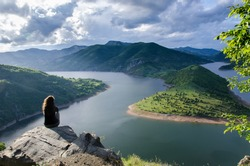 woman meditating relaxing alone Travel healthy Lifestyle concept lake and mountains sunny landscape on background outdoor