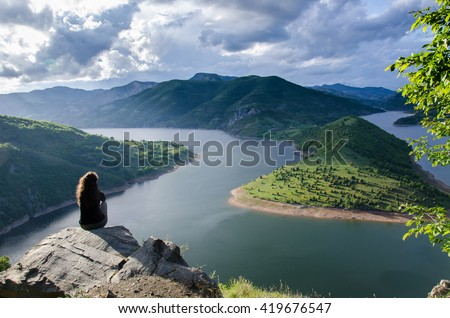 woman meditating relaxing alone Travel healthy Lifestyle concept lake and mountains sunny landscape on background outdoor #419676547