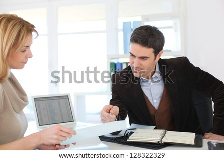 Woman meeting lawyer to set up her own business - stock photo