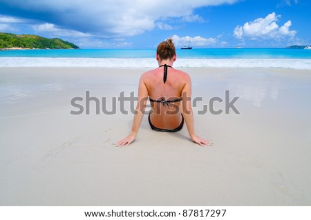 Woman meets a sunrise on the beach