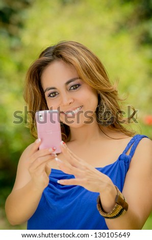 Woman messaging on her smart phone