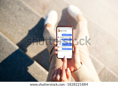 Woman messaging with her friend on phone Foto stock ©