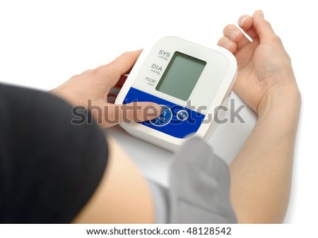 Woman metering blood pressure pulse  with sphygmomanometer tonometer medical electronic tool isolated over white