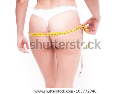 Woman misuring her ass with meter