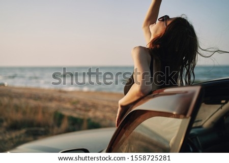 woman model on vacation in the car on vacation #1558725281