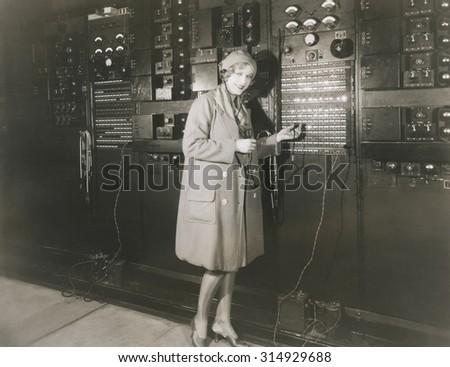 Woman monitoring sound in 1930s recording studio #314929688