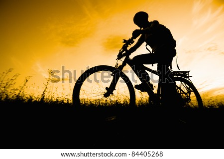 woman mountain bike sunset silhouette