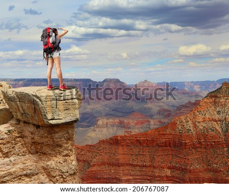 Woman mountain Hiker with backpack enjoy view in grand canyon asian