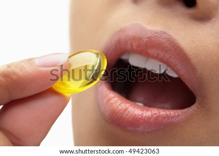 Woman mouth and capsule for health and medication concept