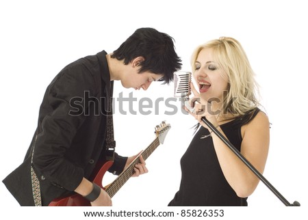Woman music singer and rocking male guitarist in garage band isolated on white