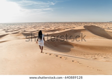 Woman my wife with white dress walking in the dubai desert sand dunes with footsteps in the dubai desert sand, Dubai Emirates, woman in the desert, foot steps in the desert, Dubai escape,woman dress