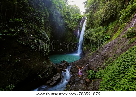Woman near Aling-aling waterfal on Bali, Indonesia