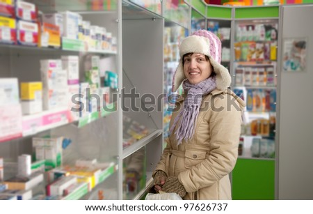 Woman near counter in pharmacy drugstore