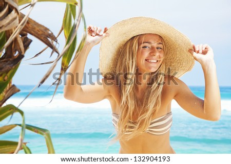 woman near palms on tropical beach